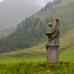 Angel on hill with alps CFA_3834